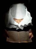 Afghan Girl Reading the Holy Koran