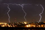 Multiple Bolts of Lightening Strike Jerusalem During an Evening Thunder and Rain Storm