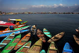 A Kashmiri Man Makes Way for His Boat on the Famous Dal Lake in Srinagar