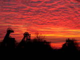 Winding Towers of the Coal Mine Niederberg are Silhouetted Against the Red Sky