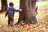 A Little Child Plays with a Squirrel