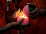 Buddhist Monks Light Candles During the Interfaith Special Prayers for Peace in Tibet