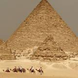 Tourists Take a Camel Ride around Mycerinus Pyramid