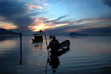 Kashmiri Fishermen Row their Boats on the Famous Dal Lake in Srinagar