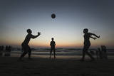 Palestinians Children Play with a Ball at Shaik Ajlen Beach in the Gaza Strip