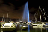 Geneva's Landmark  the Famous Water Fountain (Jet D'Eau) Is Illuminated by Blue Lights
