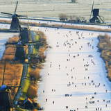 Skaters on the Frozen Canals in Kinderdijk