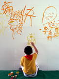 A Student Draws and Writes on a Wall