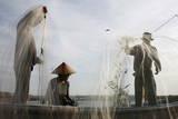 Indonesian Fishermen Collect Fish at a Beach in Kedonganan  Bali  Indonesia