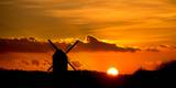 A Windmill Silhouetted Against the Setting Sun