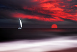 White sailboat and red sunset