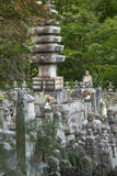 Buddhist statuettes memorialize the souls of the dead  Japan  Kyoto