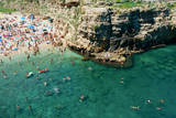 Italia  Apulia  Polignano a Mare Crowded beach on a weekend green