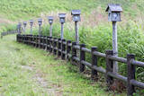 Japan  Nara Prefecture  Soni Plateau Wooden lanterns along a fence