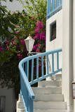 Mykonos  Greece Blue stairs and flowers in Mikonos Center downtown