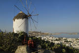 Mykonos Greece City with white windmill and grape squeezer for wine