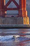 Surfing under the Golden Gate Bridge  San Francisco  California  USA
