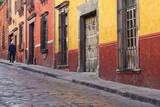 Mexico  San Miguel de Allende Elderly man walks up sidewalk