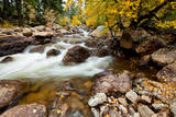 Stream cascading down the Rocky Mountains in autumn