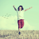Little Boy Running Feeling Happiness and Freedom