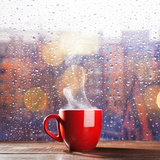Steaming Cup of Coffee over a Cityscape Background
