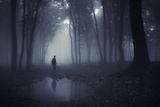 Man in a Dark Forest with Fog and Pond