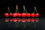 Cherries Against Black Background