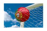Portugal Flag and Soccer Ball in Goal Net