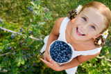 Blueberries  Summer  Child - Lovely Girl with Fresh Blueberries in the Garden