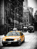 Urban Street Scene with a Yellow Taxi in Snow