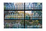 Vintage Blue Glass Bottles Against a Window