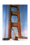 A Man Repairs a Light on the Golden Gate Bridge