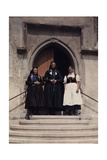Three Generations of Women Stand on the Stairs That Lead to a Church