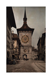 A Street Level View of a Large Clock Tower in Bern