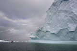 People Exploring Near Icebergs in an Inflatable Boat