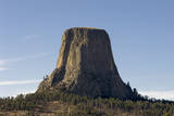 A Scenic View of the Devil's Tower in Warm Sunlight