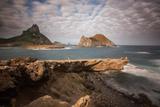 A Woman Stares Out at the Dramatic Landscape of Praia Do Sueste on Fernando De Noronha