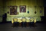 Indian Canoe Paddles Line Pressed Steel Walls Above a Dining Table and Chairs in a Restaurant