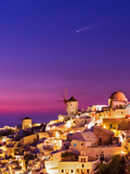 Dusk over the Aegean Sea and a Cliff-Top Town on Santorini Island a Meteor Whizzes Overhead