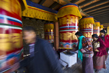 Buddhists March Past Colorful Prayer Wheels Spinning Them Whilst Making Prayers and Aspirations