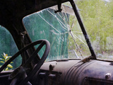 The View Inside an Abandoned Old Truck with a Broken Windshield
