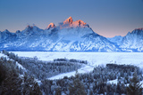 Snowy Peaks in Grand Teton National Park Reflect Sunset Colors