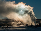 Vapor from Old Faithful Rises More Than Two Hundred Feet to Partially Obscure the Sun