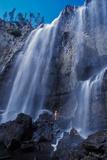 A Woman Stand at the Dunanda Falls of Boundary Creek