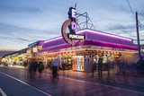 The Wildwood Beach Boardwalk and Stores at Twilight with Neon Lights
