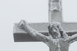 A Christian Crucifix Covered in Frost and Snow in Winter