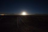 The Moon Rises over a Dead Train Line in Uyuni
