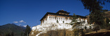 An Ancient Buddhist Monastery Perched on a Hillside Overlooking a Himalaya Valley