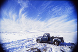 A Pickup Truck Sits in a Snowscape after a Desert Snowstorm