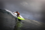 Riding a Big Swell on a Paddleboard in Waipi'O Bay